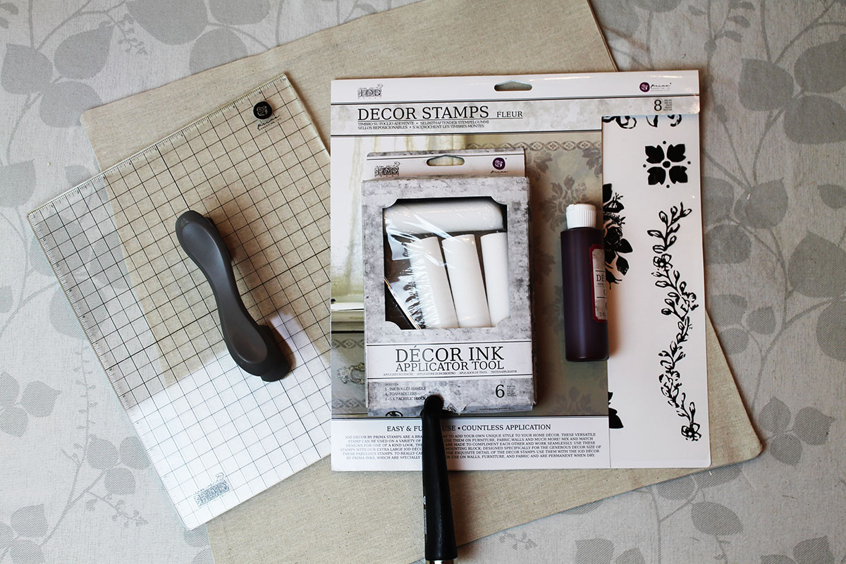 Gather up your tools and supplies! Here is what I used:  Fleur Home Decor Stamp Set, Roller, Home Decor Ink (20 Years Port), Acrylic Block (optional-you can stamp freehand too), Pillow Cover from Hobby Lobby (4.99) and the filler for the pillow.