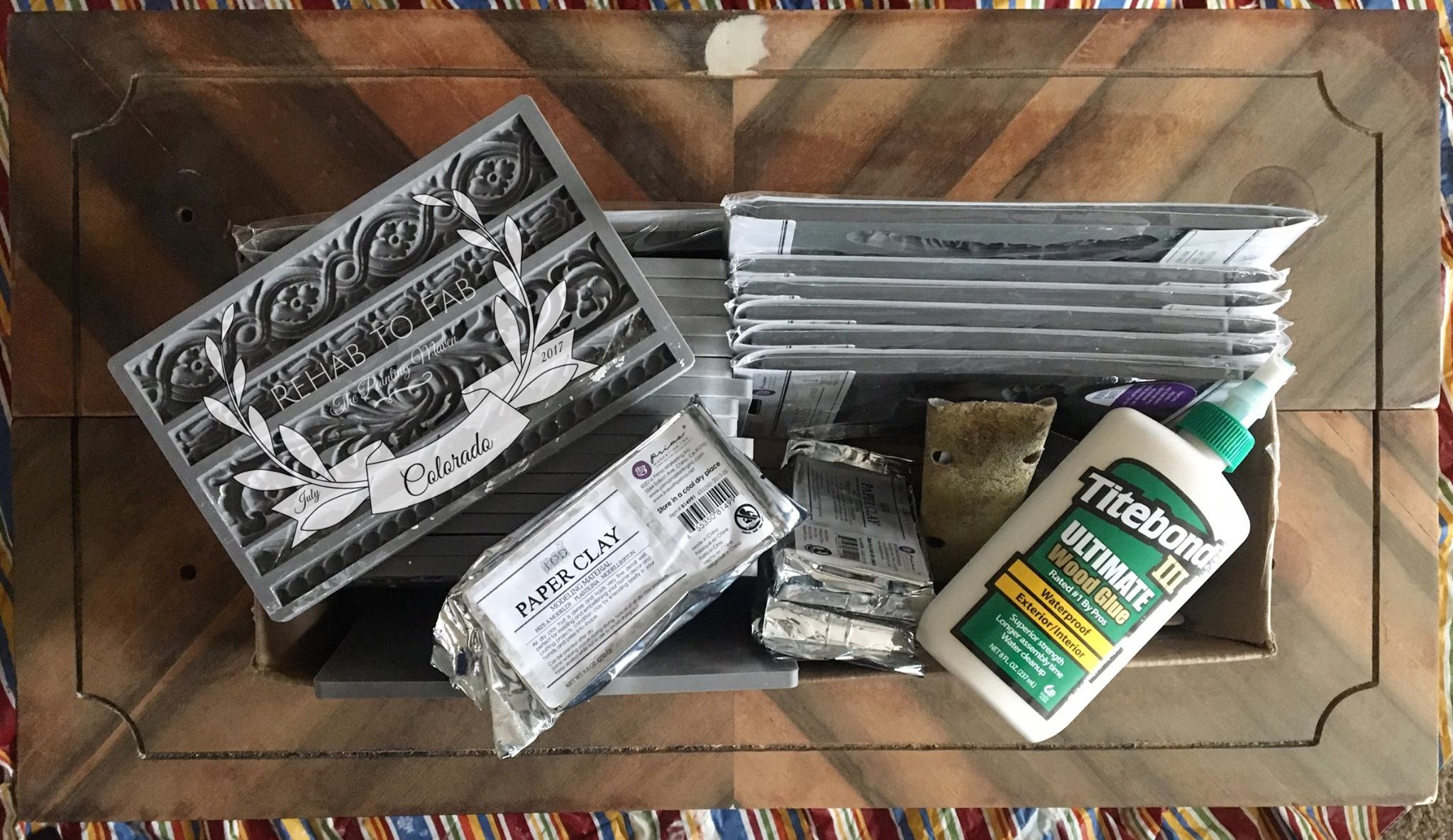 Gather up your tools to begin. Moulds, paper clay, sand paper, Bondo and Titebond III.....