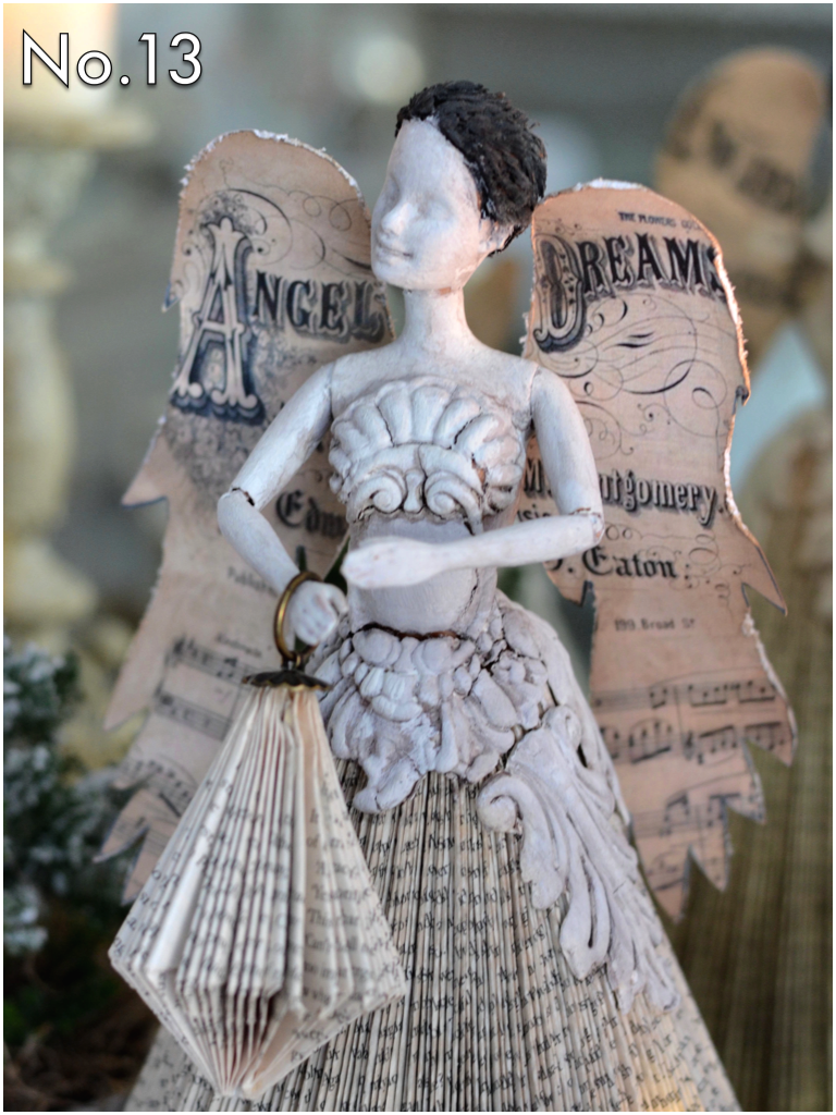 Paint the doll and appliques with white gesso or a chalk style paint. Add darker wax or powder to bring out the details and add shading. For the wing template, head over to  Catarzyna's blog  to download the pdf. Just print and cut out, then attach to the back of the doll.