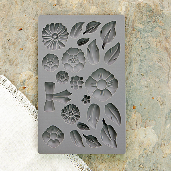 This was the IOD mould I used called Rustic Fleur-815363. This silicone mould is food safe if you would like to use it for cakes, chocolates, etc.. In the mould, I used IOD paper clay for my projects-it works great!