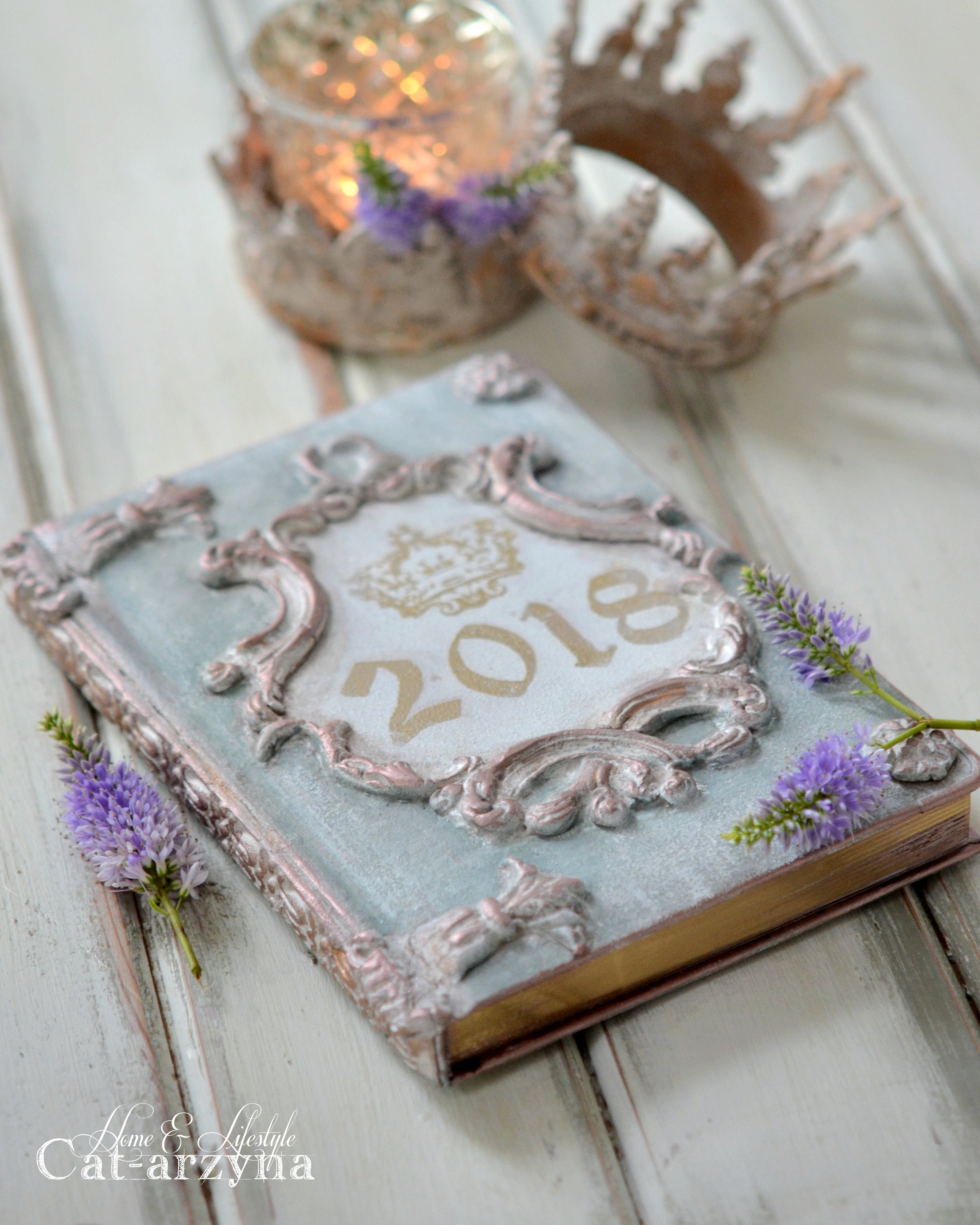 With the new year,comes new plans! Cat-arzyna altered this plain (and dark) planner for 2018 using a variety of mediums, tools and ingenuity. Lets see what she did...
