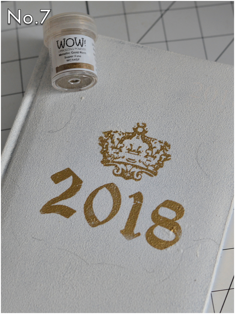Add embossing powder over the stamped images, then heat set with a heat gun. Notice the little pencil marks she made so she could replace the appliques in the position they were in before she stamped...very clever!