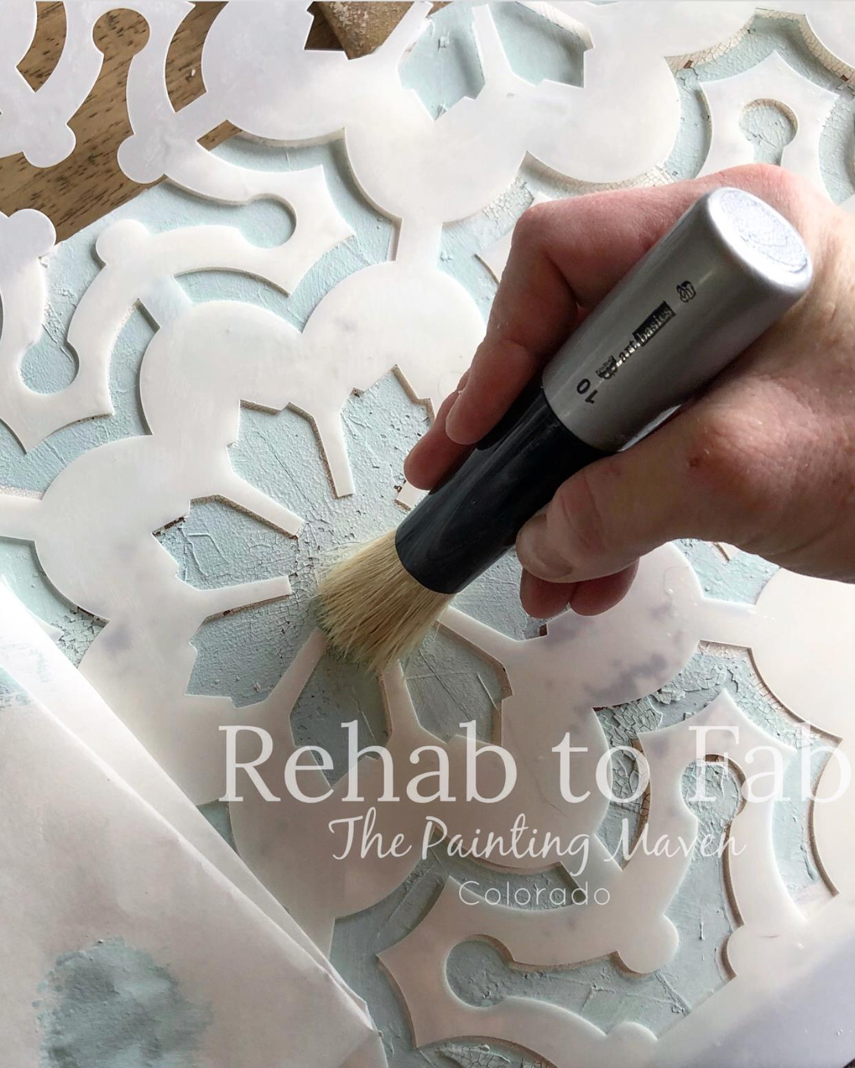 Apply the paint using a stencil brush and use a very small amount of paint over the stencil. The brush has to be almost dry. Dab off excess paint before applying. This will prevent seepage under the stencil and give you a nice clean edge to your design.