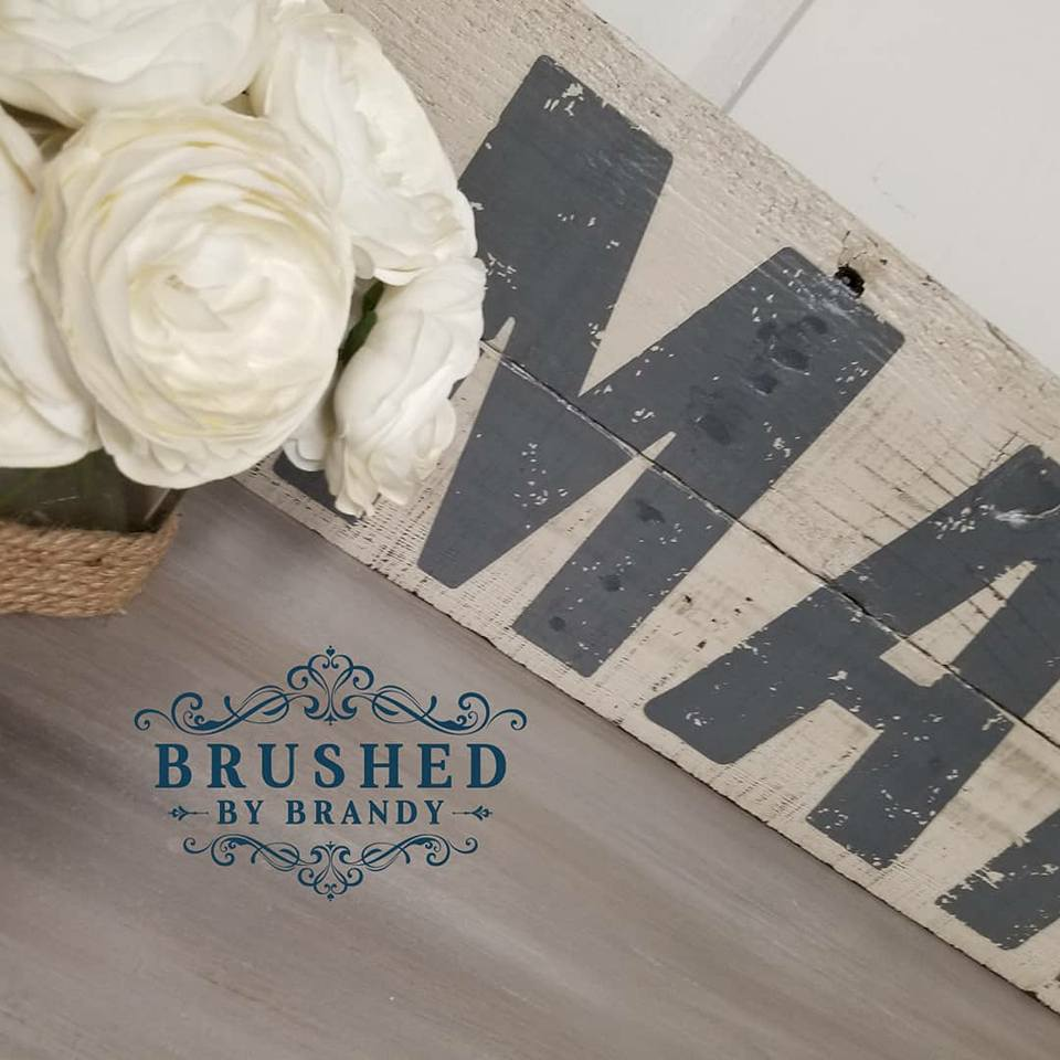 Brandy repurposed two old picket fence posts to create her sign. She sanded them a bit, added the transfer and then applied Dixie Belle's clear coat to seal it.