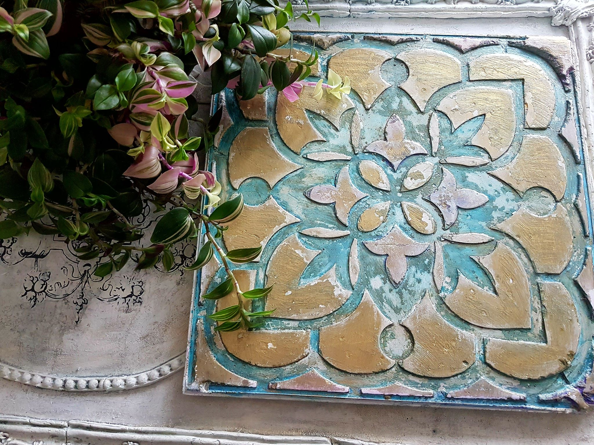 Are you a gardener? Or do you need to add some personality to your landscaping? We are so excited to introduce our new concrete paver moulds. This new DIY tool is engineered to help create concrete stepping stones or pavers using concrete and stencil inserts to get the style you need for your outdoor living space. This example was created by our home decor team member,  Magdalena Salacinska of Secret Garden Chic . She added a mixture of paint colors to give them a bit more pizazz!
