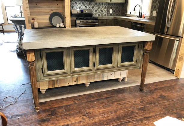 Here is the kitchen island we built using old cabinets from the original kitchen. (It pays to save them). You can see it's not quite finished but the legs and cabinet fronts match the kitchen cabinets perfectly, creating a nice cohesive look. Originally, we were going to paint the legs, but did the wax instead and they look perfect...