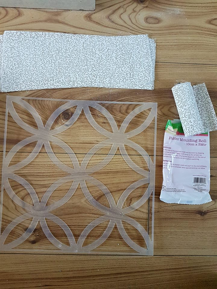 To start, choose the stencil pattern you wish to use. You will need plaster bandages. These were used way back in the day to build casts. These bandages will give the plaster of paris strength to keep the plaster from breaking and help build up the thickness of the tile itself.
