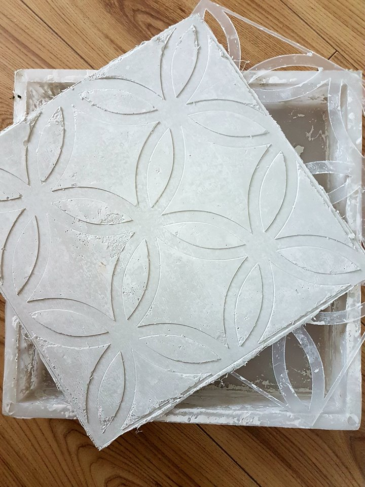 Once it has dried, you can remove it from the mould. Then peel off the stencil to reveal the pattern. Magdalena said her tiles took about 30 minutes to dry in the mould. Again-the drying time will depend on how many layers you have. More layers will mean more dry time.