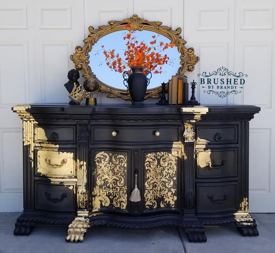 We like to refer to this buffet as Black Beauty. It is regal, stylish and stands alone in it's beauty. Here she added gold leafing to one of the redesign stencils, Imperial Damask (coming out mid August) to bring out the pattern and freehand on the rest to make it flow. This is definitely an exquisite statement piece...