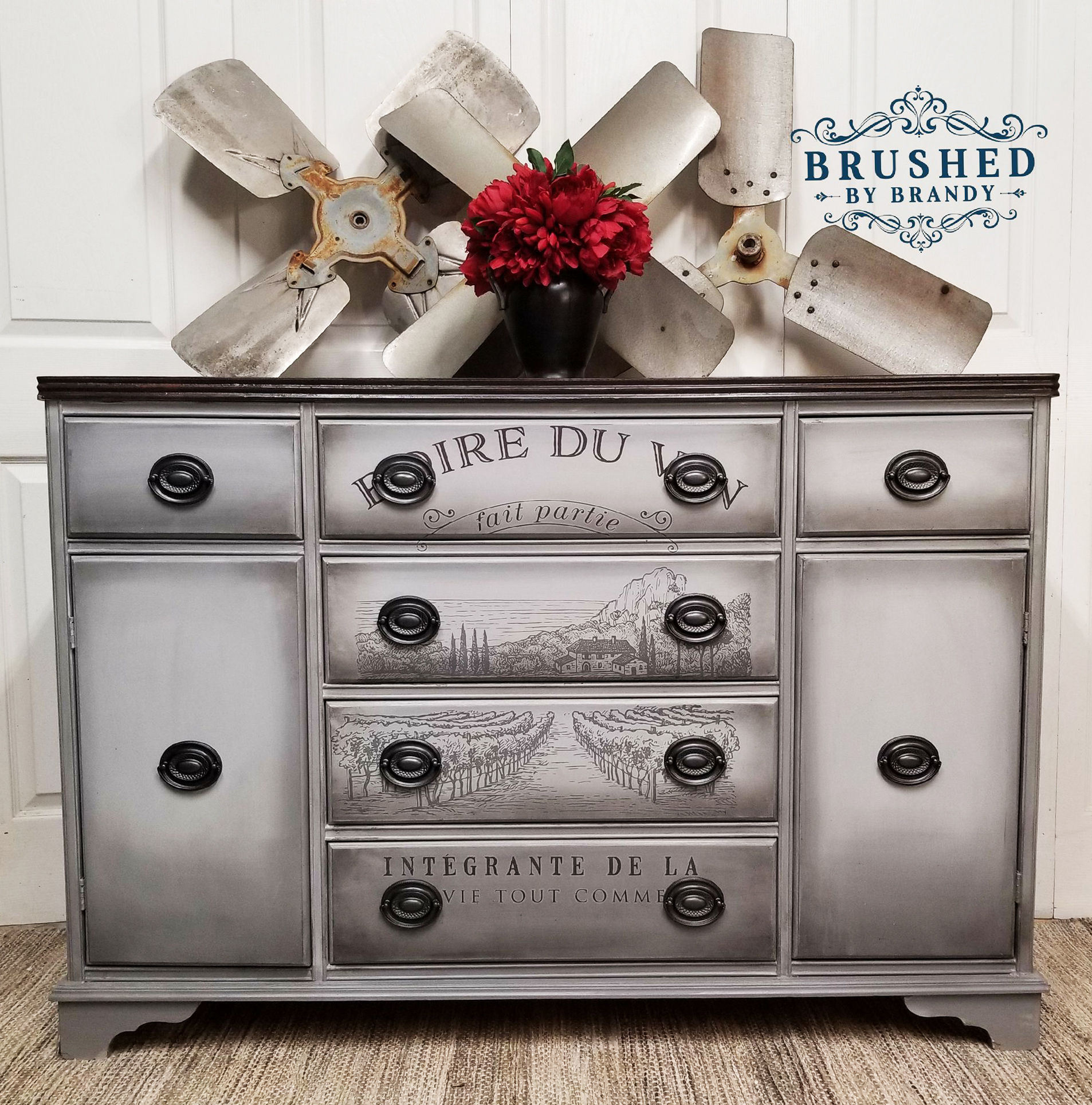 This sweet buffet was given new life in a monochromatic tones along with the addition of our Boire De Vin transfer. The blending and highlights really accentuate the transfer perfectly. She used Manatee Gray, Gravel Road and Grunge Gray wax by Dixie Belle. LOVE!