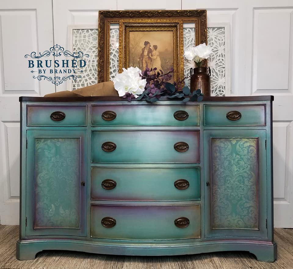 OK-there is where you ask yourself-how did she do that? Brandy is notorious for her blending talent and you can really appreciate it here.The iridescent finish makes this piece glow!She used our Imperial Damask stencil on the doors along with our Diamond Dust wax paste along with Dixie Belle paints, Amethyst and Mermaid Tail and more...