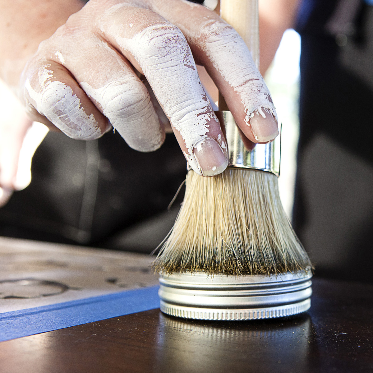 Grab a hold of a wax brush, and start dabbing in the tin. Tap off excess onto paper towel or cloth. Make sure you coat the brush as evenly as possible.