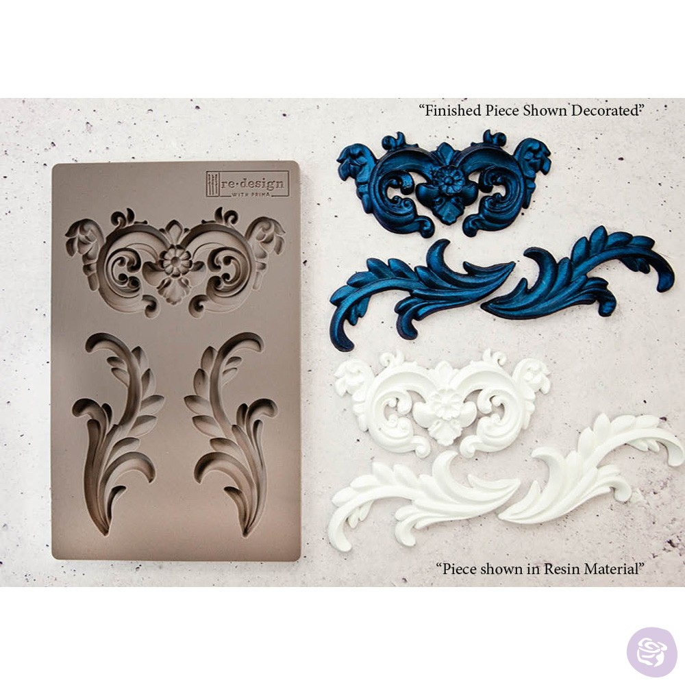 This is the [re]design mould, Everleigh Flourish. These designs can be used individually or together for one large unique design. Michelle used the flourishes from the set to add to her frame.