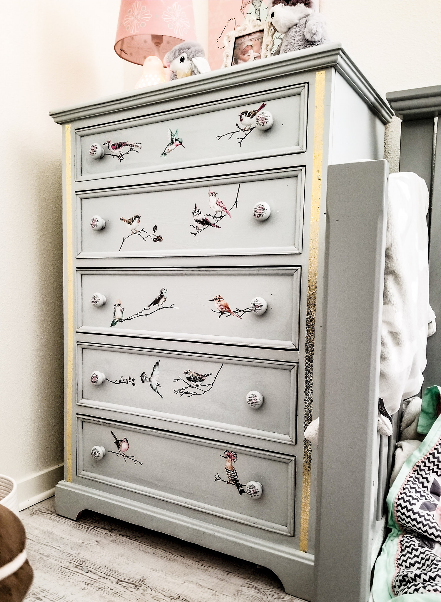 The bit of gold on the changing table works beautifully with the butterflies-dont you think?