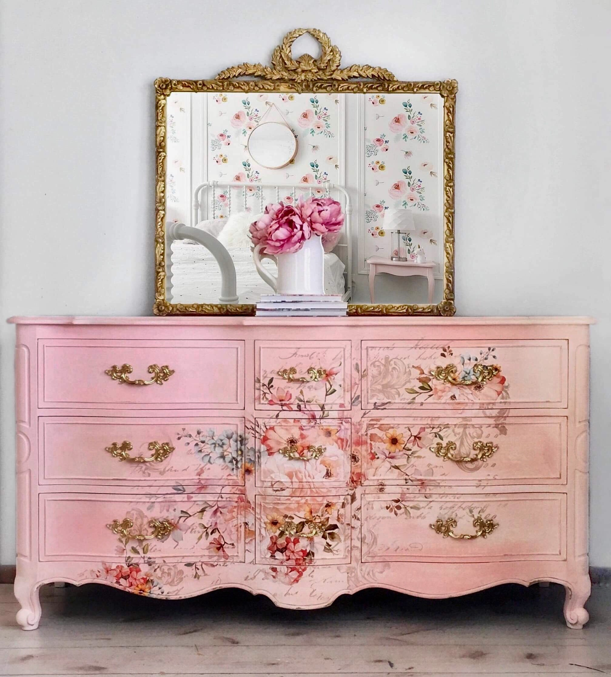 """This gorgeous French provincial dresser was hand painted in beautiful shades of pink and adorned with the """"Rose Celebration"""" Decor Transfer™ across the front. The transfer works perfectly with the details, curves and vintage hardware that make this piece a one-of-a-kind beauty."""