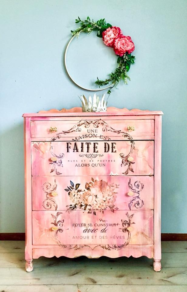 """This fabulous piece has all of the beauty and elegance of a bygone era. This wonderfully shabby girl has been hand painted in a gorgeous palette of pinks, creams, corals, and accents of gold; then heavily distressed. Kim used our """"L'Amour Et Des Reves"""" Decor Transfer™ and it's perfect!"""