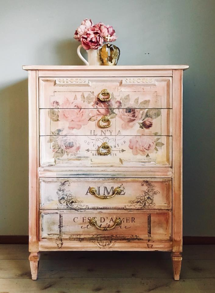 """This is is everything! This lovely french lady was made by the venerable Dixie company; known for their outstanding craftsmanship. She has been hand painted in a beautiful palette of peach, pink, and cream with a gorgeous French motif on the front using the """"Dans La Vie"""" decor transfer™! Heavily distressed and sealed she oozes old style romance and glamour."""