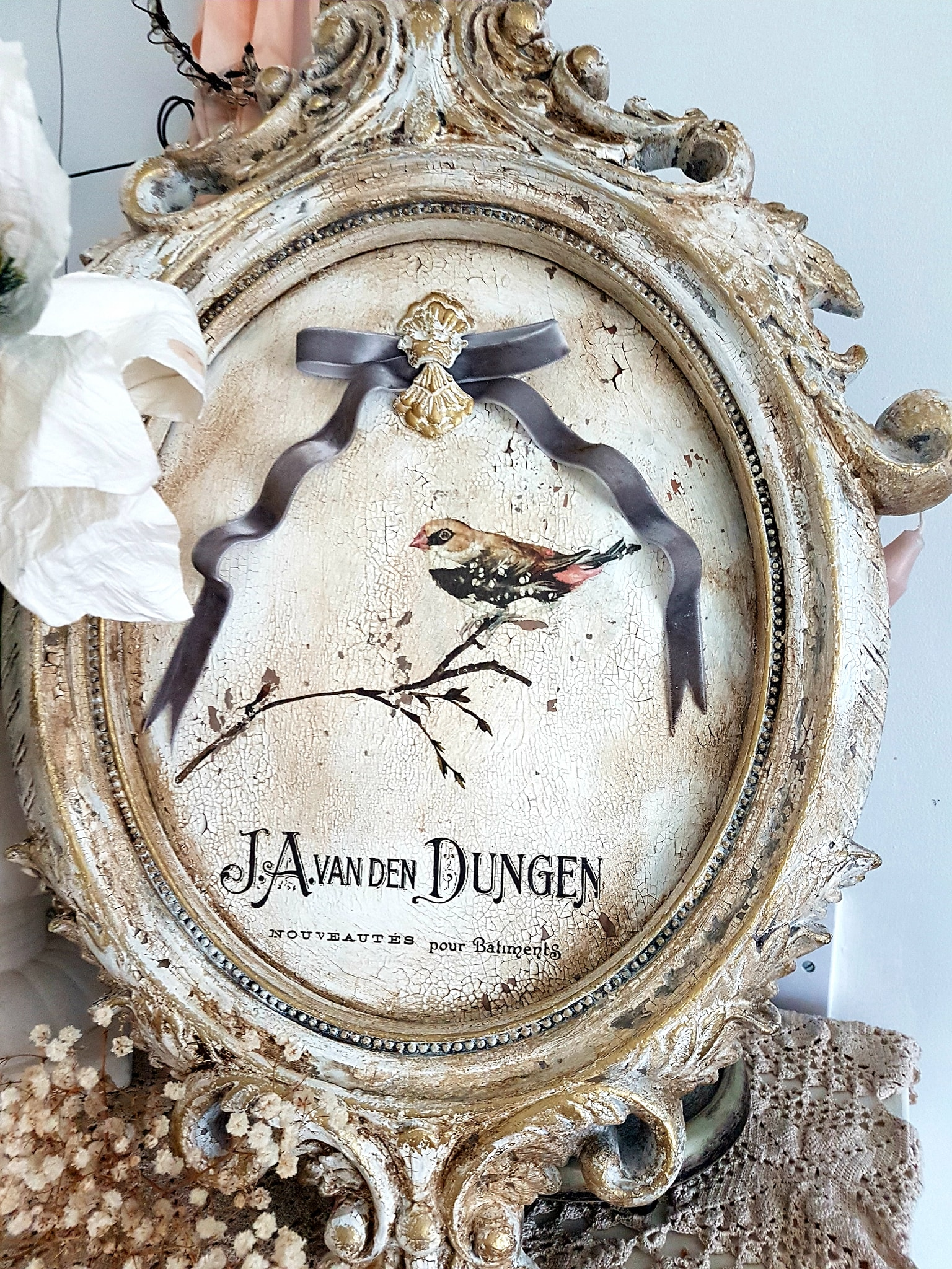 For this frame she applied crackle paste, white Chalk Paste®, Eternal Decor Wax and the Van Dyke Glaze. The chippy-ness is fantastic. You would never know this started off as a plastic frame from the dollar store.