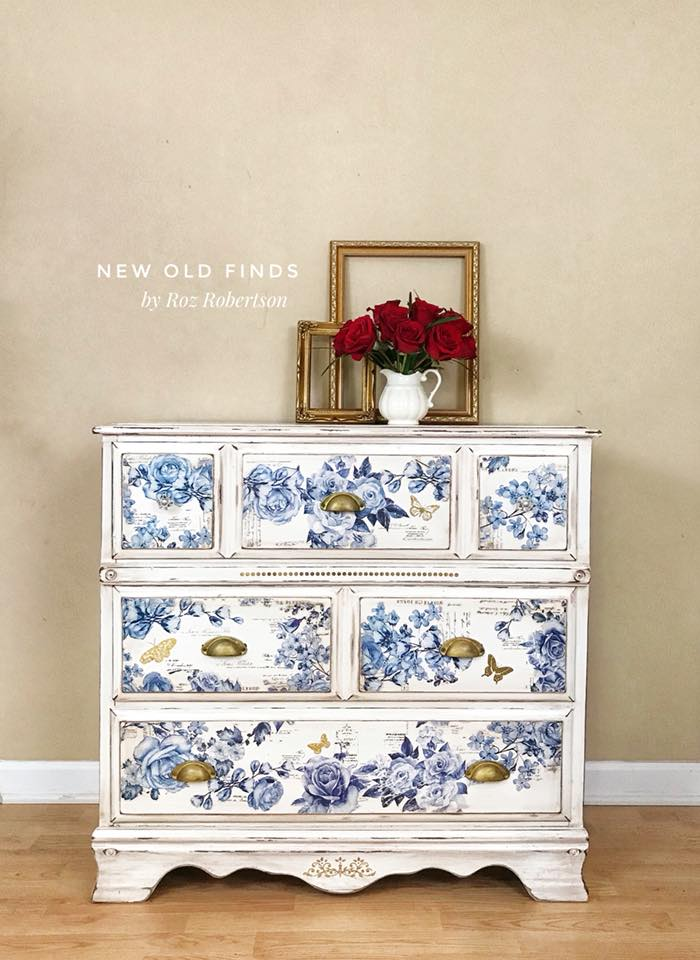 This dresser is a show stopper! Painted in a crisp white and distressed along the edges to give it a rustic shabby touch. The French Ceramics I (635831) set was used on the drawer fronts. The blue flowers look amazing against the white background….