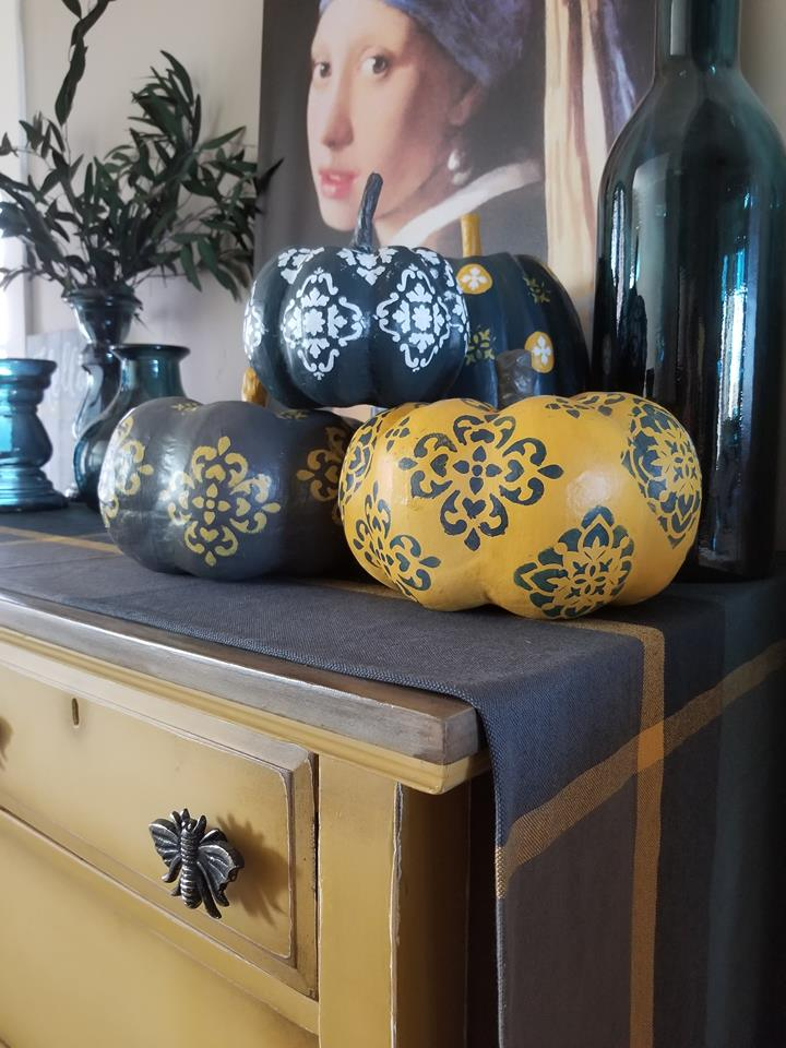 She said she was able to get a ton of use out of single piece without any issues. Plus, this is a perfect example of how they can be used on a curved, uneven surface. Brandy used Dixie Belle paints to paint the pumpkins along the stencil designs too. The chalk paint works great because of the adhesive backing, which helps keep the paint in place to avoid seepage…
