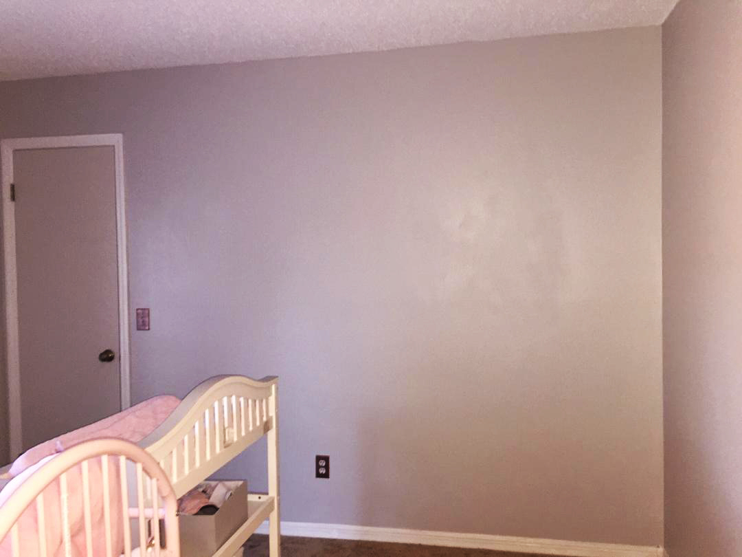 The walls were given a fresh coat of paint. The color is Sterling by Benjamin Moore Paints. As you can see, she had a clean slate to work with, but this can be daunting-so much space to fill and how do we add character without over doing it? Or perhaps not doing enough?