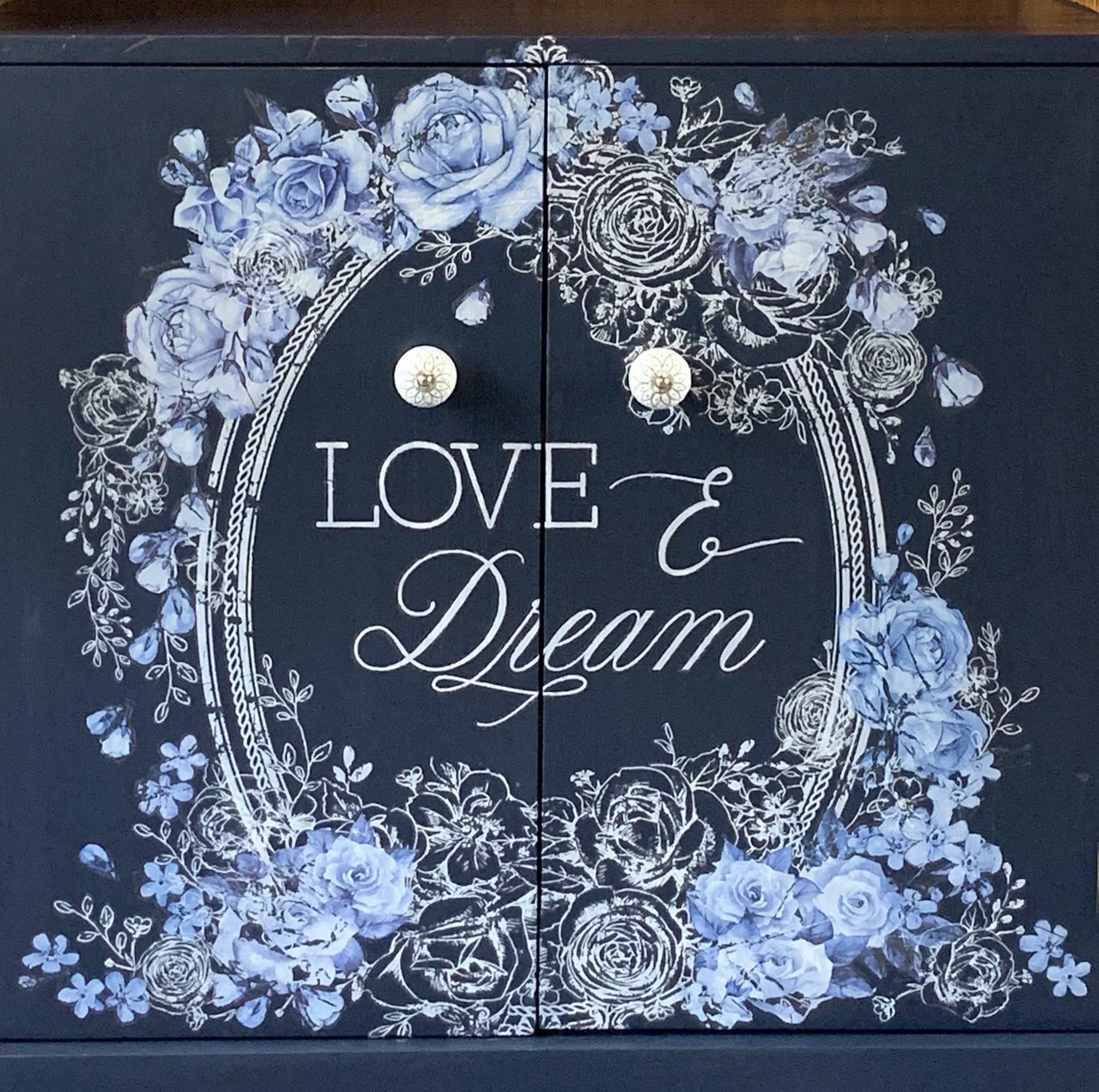 """Finished in this wonderful Navy blue, floral transfers in gorgeous whites and blue all compliment the natural wood…""  The Love and Dream Decor Transfer™(637033) is white and measures 22 x 28 inches, so it shows up especially well on dark backgrounds ."