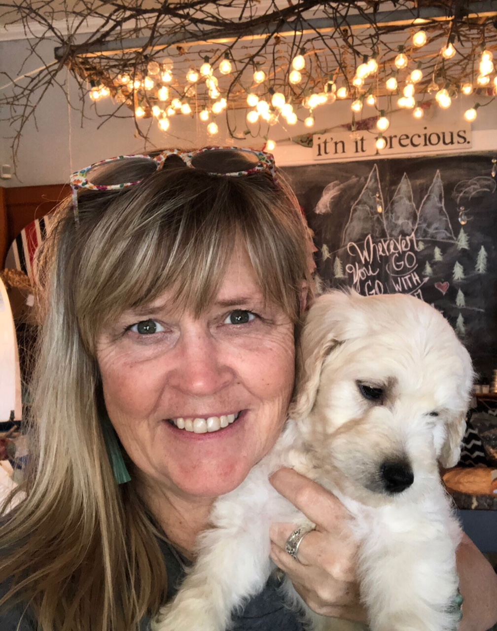 "My name is Sherri and I'm a #dogmom. This is Stanley my golden doodle when he was a pup. I have 3 married children who have given me 5 of the sweetest grands on earth who call me ""ma'am!"" ( They.melt.me .) I'm the co-owner of a shop called Front Room on 7th, which is in Southwest Ohio! I'm a creative (it's in my DNA) and love to re-purpose vintage treasures. I'm also a furniture artist. Whimsy is what makes my heart race, but if painting something gray is what ""sparks joy"" for someone, I can respect that, but I'm wanting to add harlequin patterns while I work on it. ;) My bedroom had been on the ""to do list"" forever, but moms sometime take a backseat, and that's okay.  Winning the Redesign with Prima Facebook contest gave me the chance and motivation to turn my drab bedroom into a whimsical haven where I'll look forward to reading and resting at the end of each day! So, it's not a man cave... but it makes me smile! I did a Facebook live ""unboxing"" when the package came, it wasn't hard to tell I was excited!"