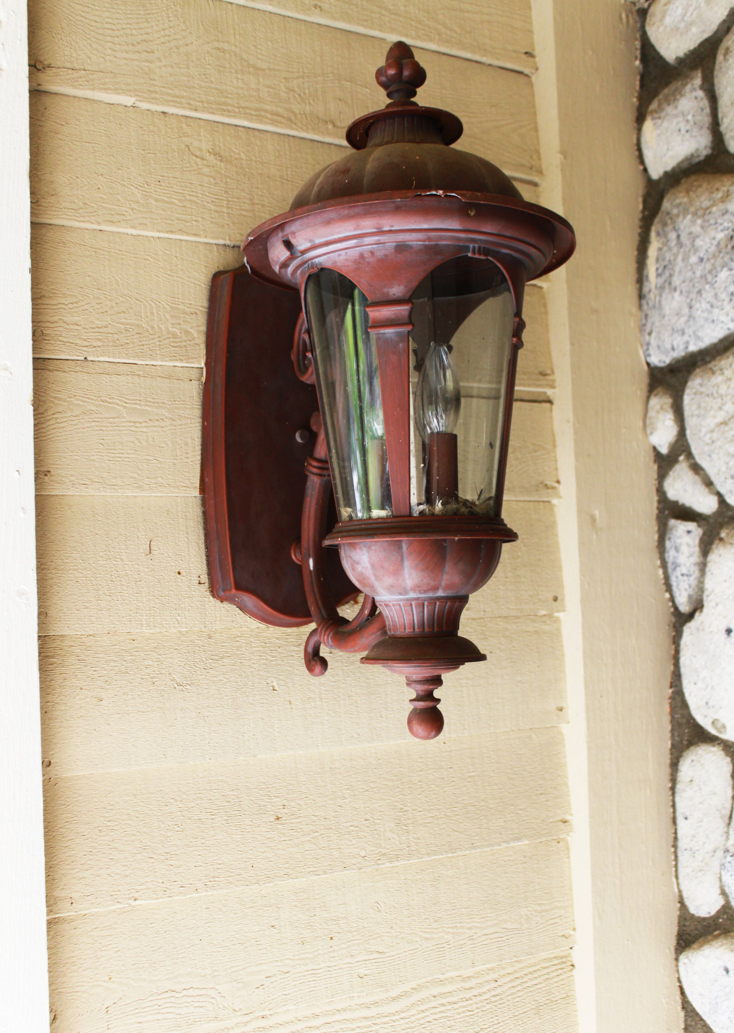 He started by taping around the plate, removed the glass and top. Then he added an outdoor paint that can be used on metal. There are several kinds and colors to choose from out there so pick the color that matches the colors of your home.