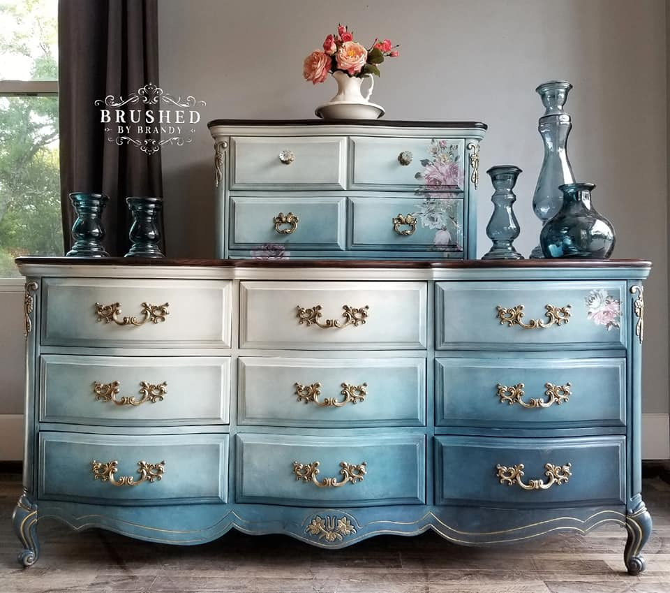 These French Provincial pieces got #brushed! Brandy applied her skilled blending technique in hues of blue and gave them a lovely rustic finish. Then she applied the Fuchsia Sunset Transfer to add floral details…stunning!
