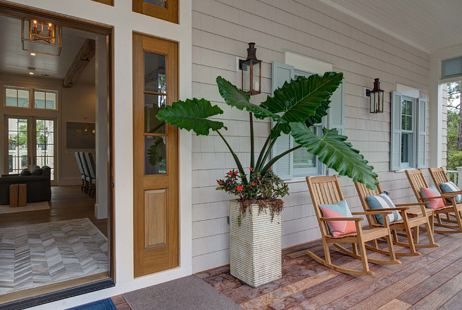 A front porch at a home in Santa Rosa Beach. Photo credit 1 below.