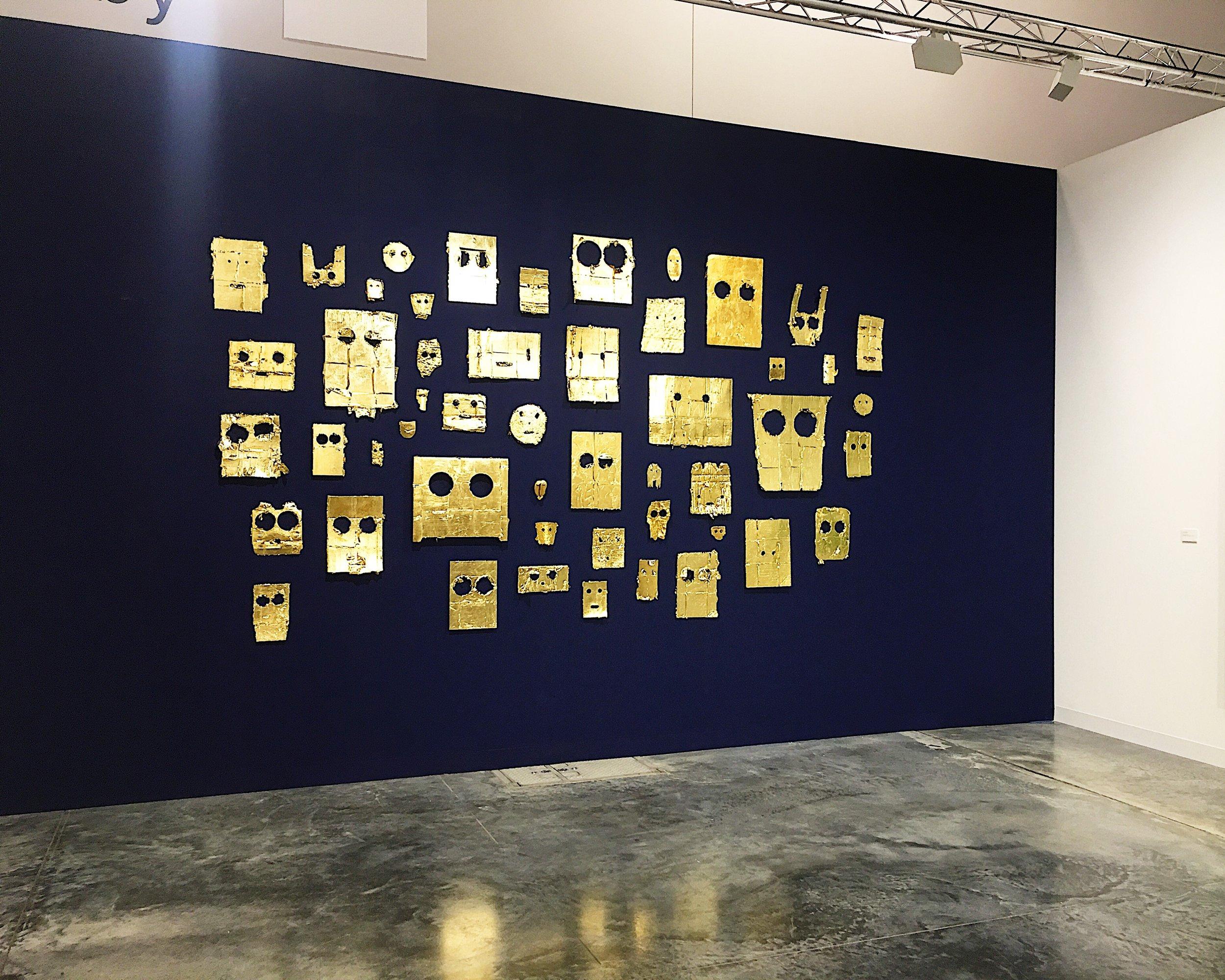 Peter Liversidge A Wall of Gold Masks.JPG