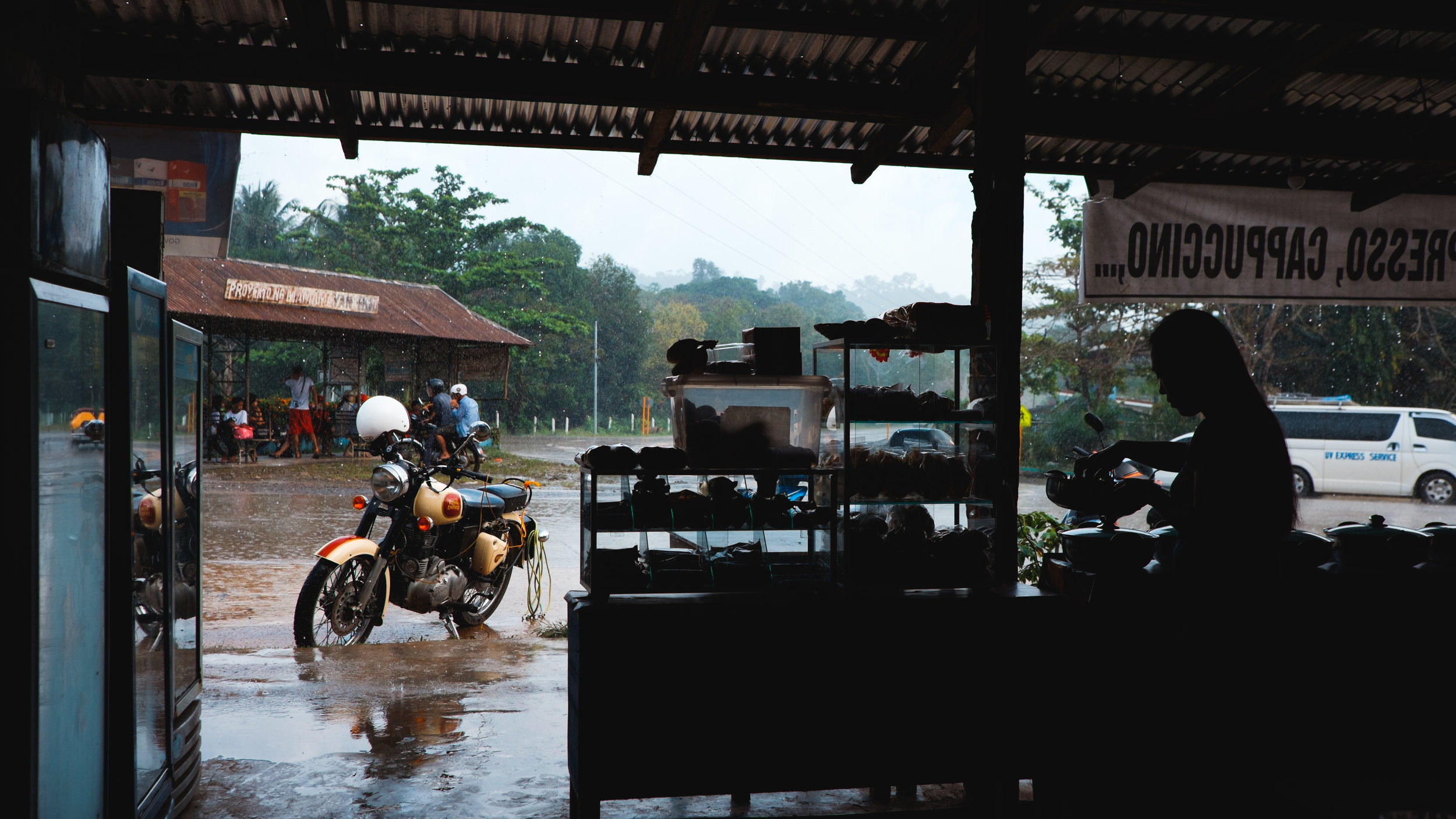 Heavy rains while a woman preps food to sell.