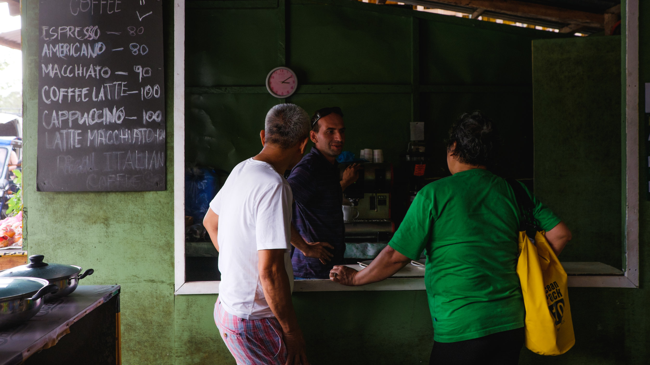 My parents getting coffee. The prices are in peso (Philippines currency).