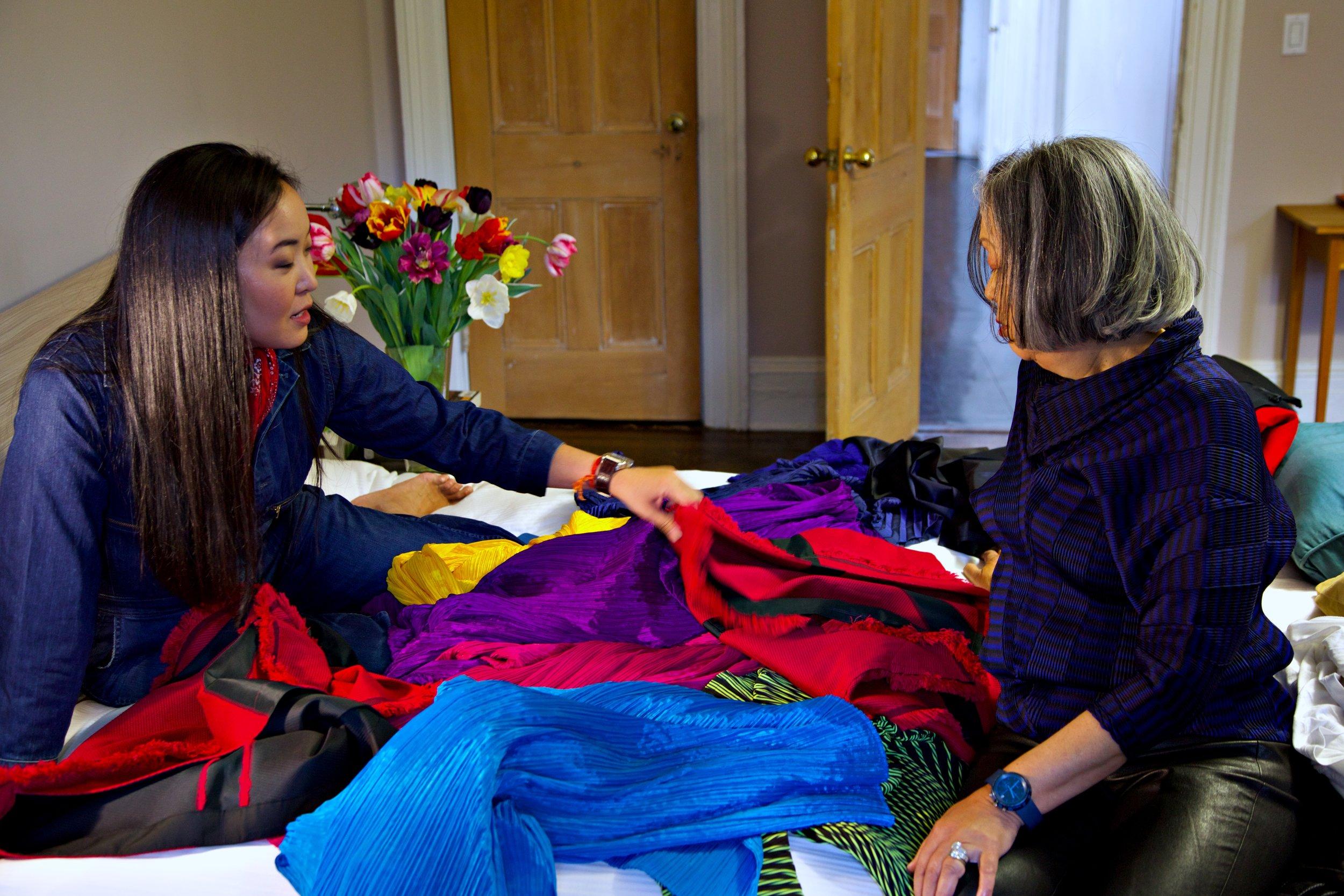Aya and Jun looking through Jun's collection of Miyake scarves.
