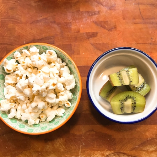 Popcorn and kiwi! I love kiwis, they are packed with vitamin C, potassium, fiber and vitamin K to name a few. Grab some next time you're at the store.