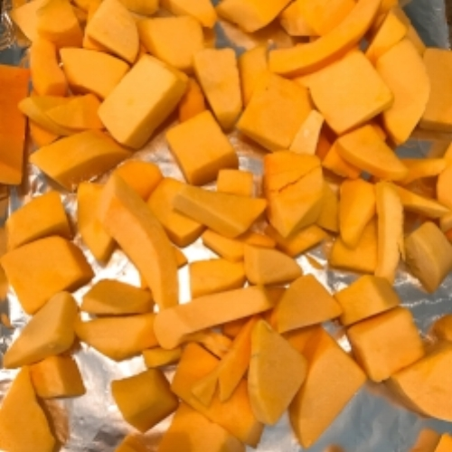 Raw butternut squash. I bought the pre-cut packaged kind. You can easily cut a whole squash in half, roast and then scrape out, this is an easier option and saves some time. I drizzle extra virgin olive oil over the squash along with salt and pepper. Roast for 40 minutes or so in a 400 degree oven.
