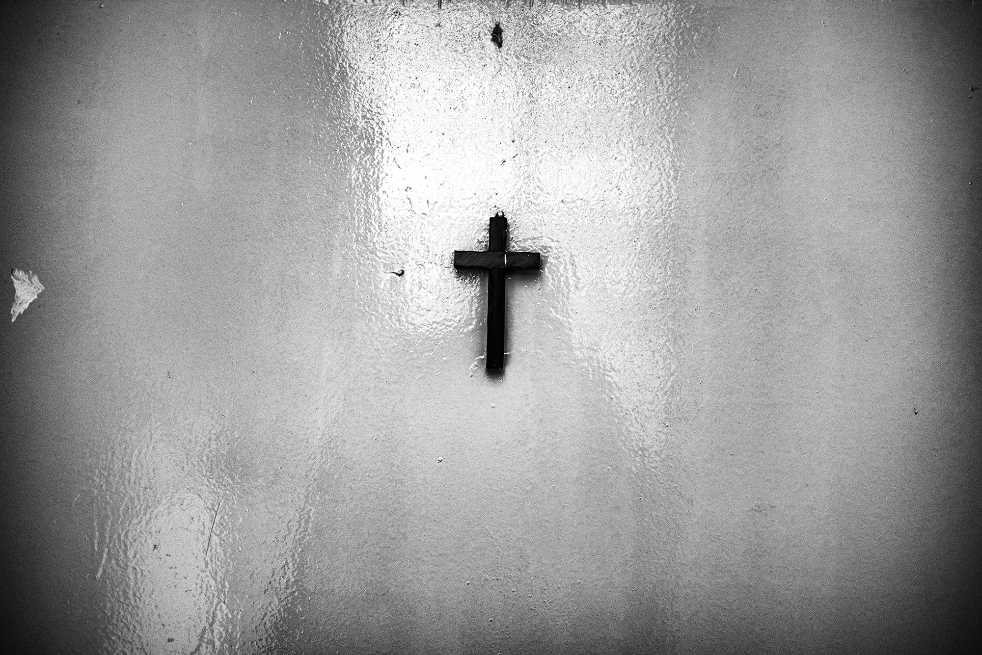 A cross on the outside of a door to an apartment where Chin refugees live in Kuala Lumpur.