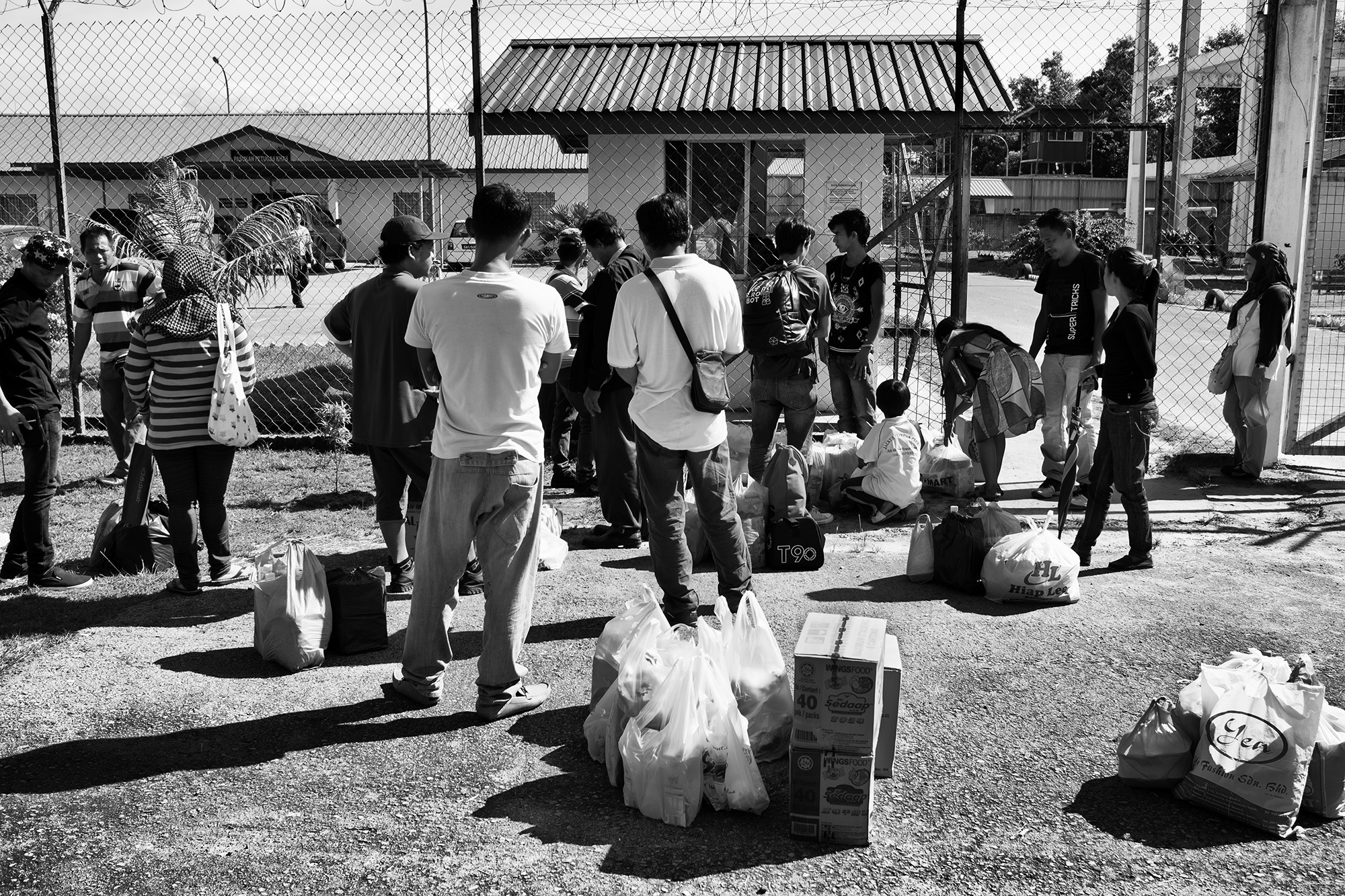 Families bring simple food, toiletries and other essentials to family members in Kimanis Detention Camp in Paper, Sabah.