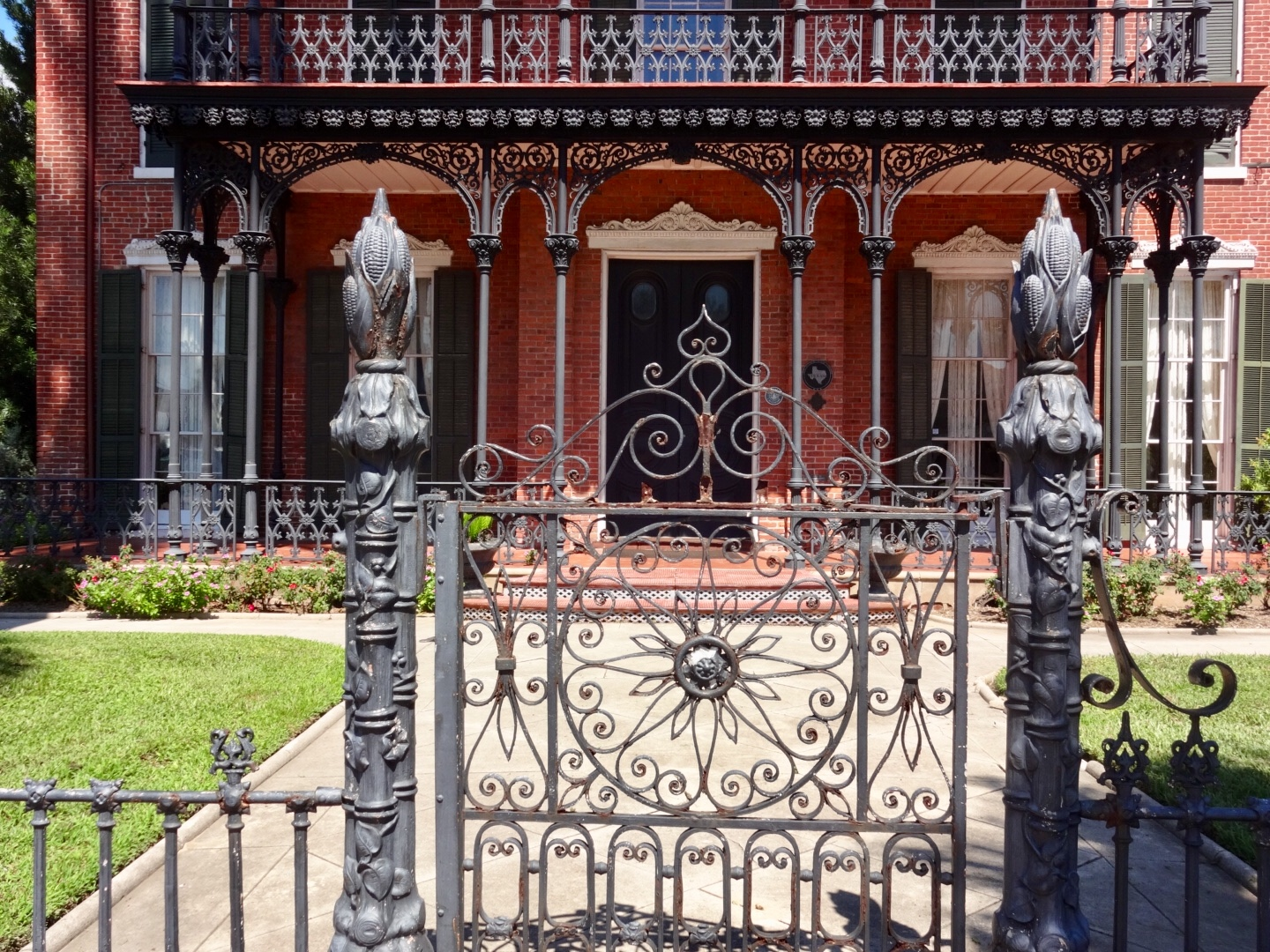 Original wrought ironwork. I imagine the moment those people stood gathered out there and found out they were free. Photo taken in 2018 by me.