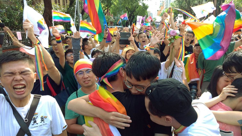 (The Associated Press)Same-sex marriage supporters hug outside the Legislative Yuan in Taipei, Taiwan, Friday, May 17, 2019, after Taiwan's legislature has passed a law allowing same-sex marriage in a first for Asia. The vote Friday allows same-sex couples full legal marriage rights, including in areas such as taxes, insurance and child custody. (AP Photo/Chiang Ying-ying)