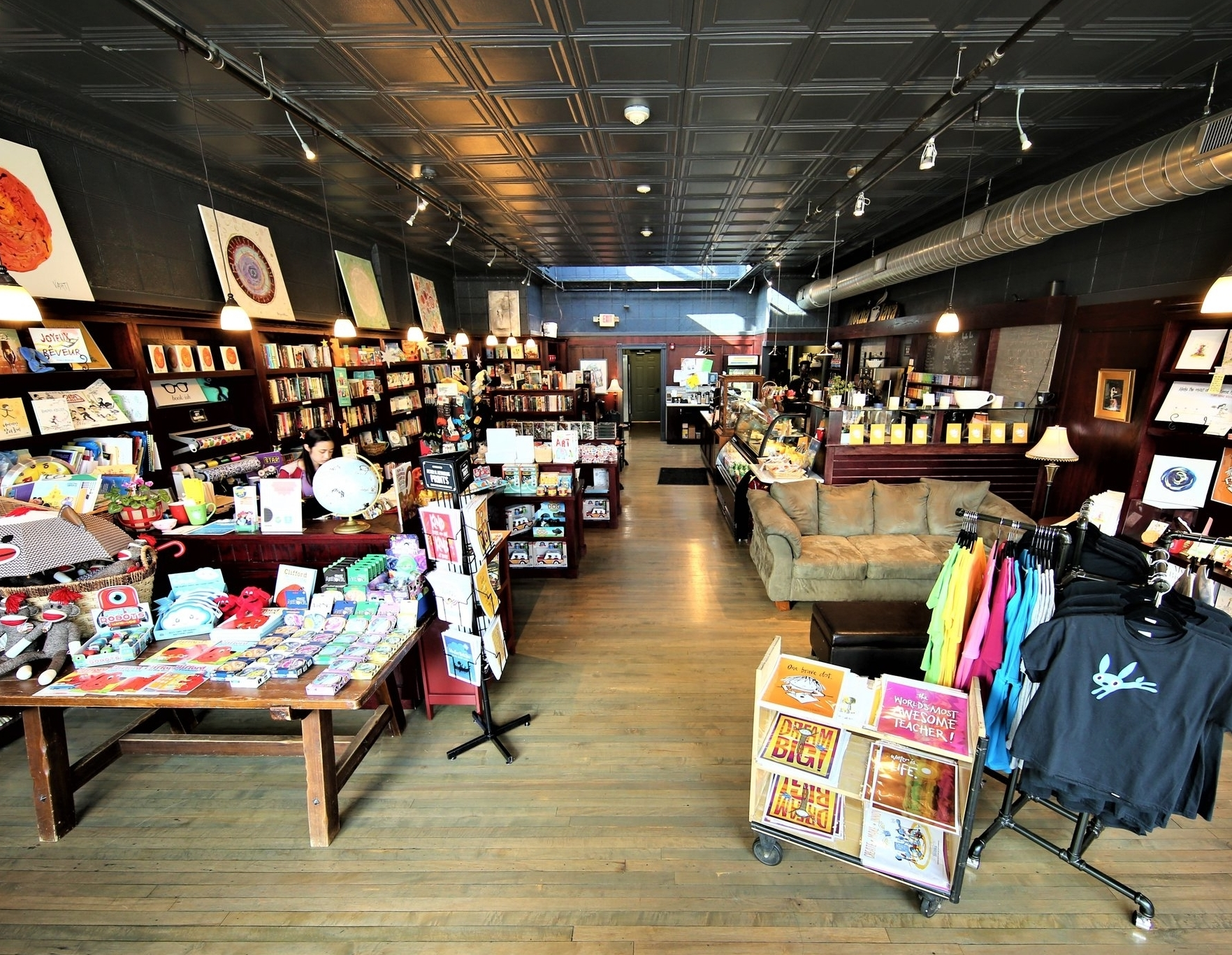 About the Shop - Peter opened his bookstore in Dedham in 2003 to fix a glaring problem: there was no bookshop in his hometown! The shop, packed with books, toys, games, and art supplies, was originally only 800 square feet and called The Blue Bunny after local famed Dedham pottery. Eventually the shop moved down the block to a larger space, and two years ago a cafe was incorporated - coffee and books - the perfect combination! The shop is now managed by his daughter, Sarah Reynolds.