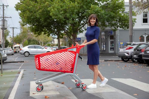 Sally Williams pushes a Mid-sized Hybrid Trolley made from recycled plastic.