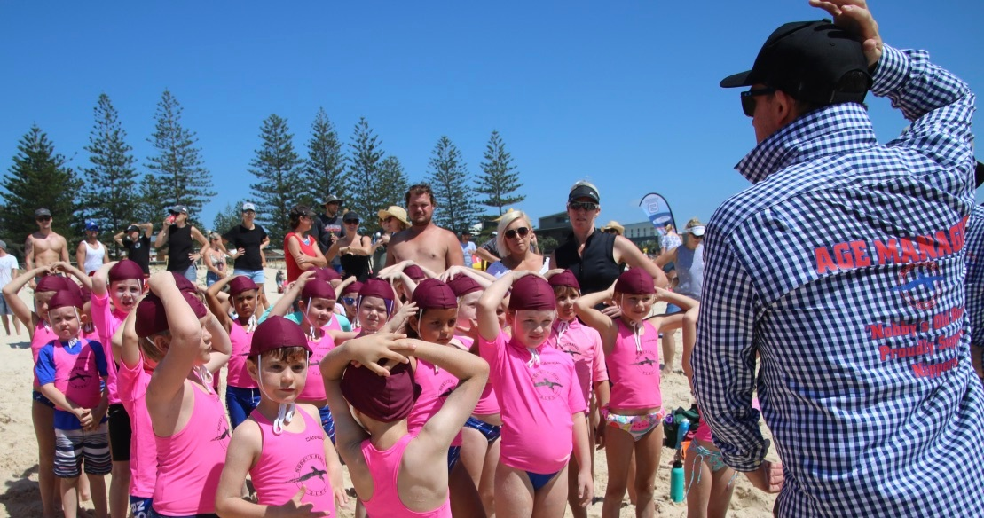 Nippers being taught important surf safety skills