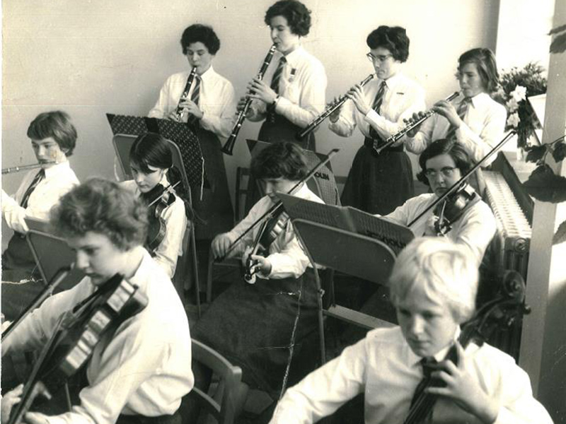 Celia (bottom right) playing the cello in the school orchestra