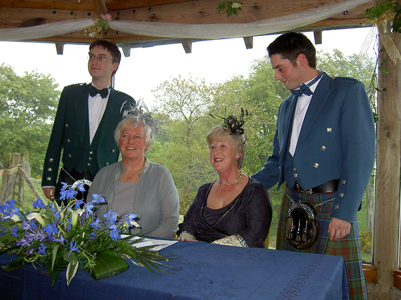 Celia and Diana with Diana's two sons, Nick and Alex, at their Civil Partnership in 2006.