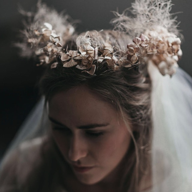 The photographer's eye and craft beautifully capture an angelic portrait adorned with a crown of foraged hydrangea, smokebush and love in the mist. Collected from the gardens surrounding the studio. Studio#atelier#dressmaker'satelia#garden#foragedflora#bridalcrown#bridalheadpieceflowers#handmadecrown#floralcrown#fashioned#bridalshoot