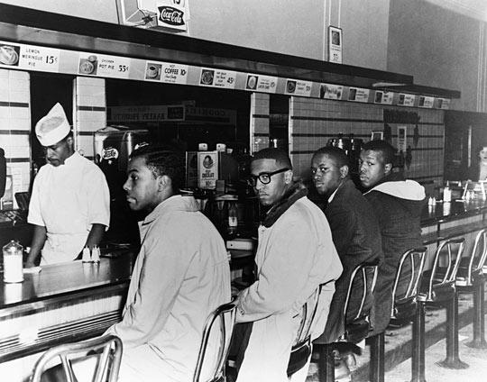 The Greensboro Four (Joseph McNeil, Ezell Blair, Jr., Franklin McCain and David Richmond) were students at North Carolina A & T State University. In 1960, they lodged a sit-in at Woolworth in Greensboro, N.C. to desegregate the lunch counter. Within weeks, there were sit-ins at lunch counters throughout North Carolina.