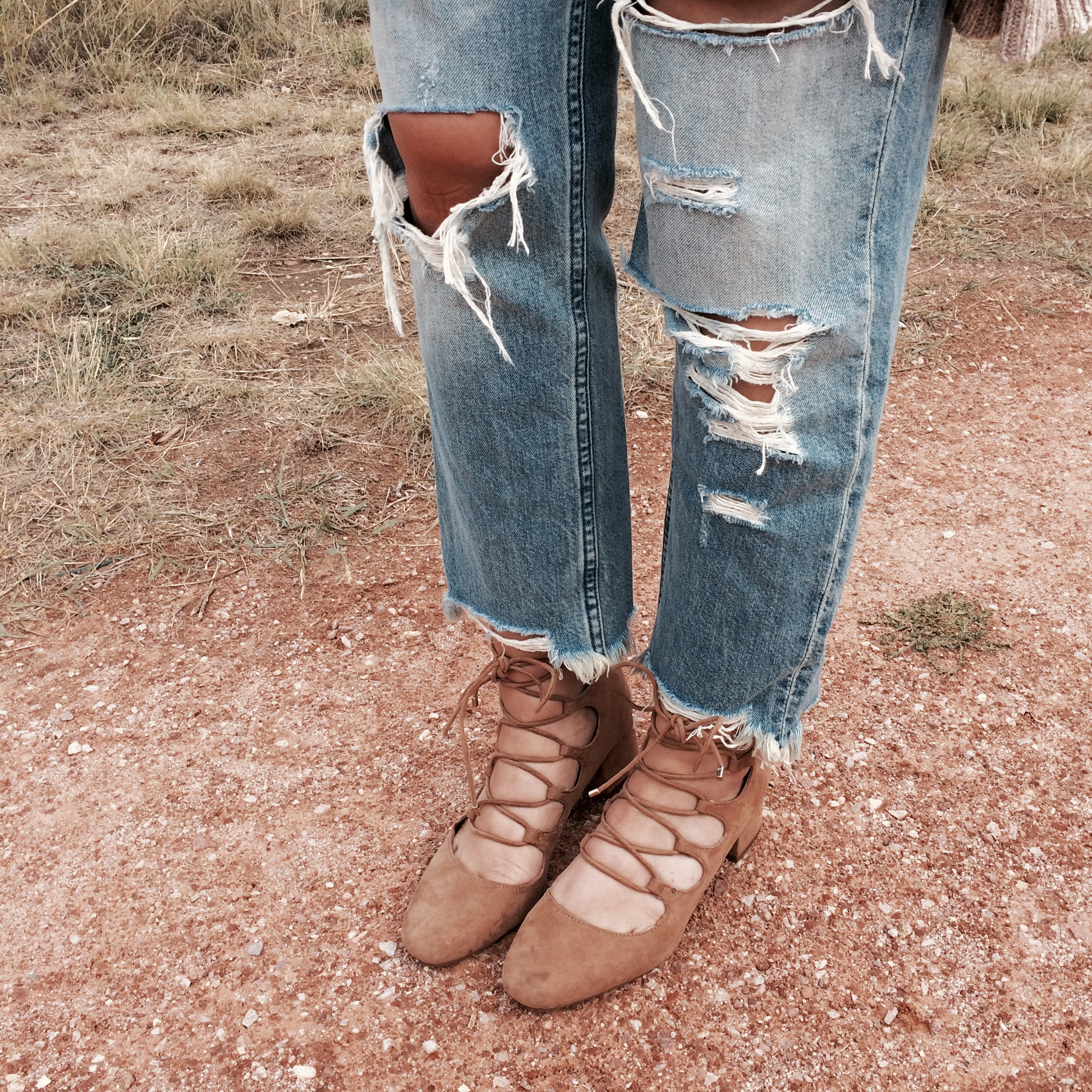 Here's a close up of the distressing. I love that these jeans are slightly cropped and how the ends are frayed.