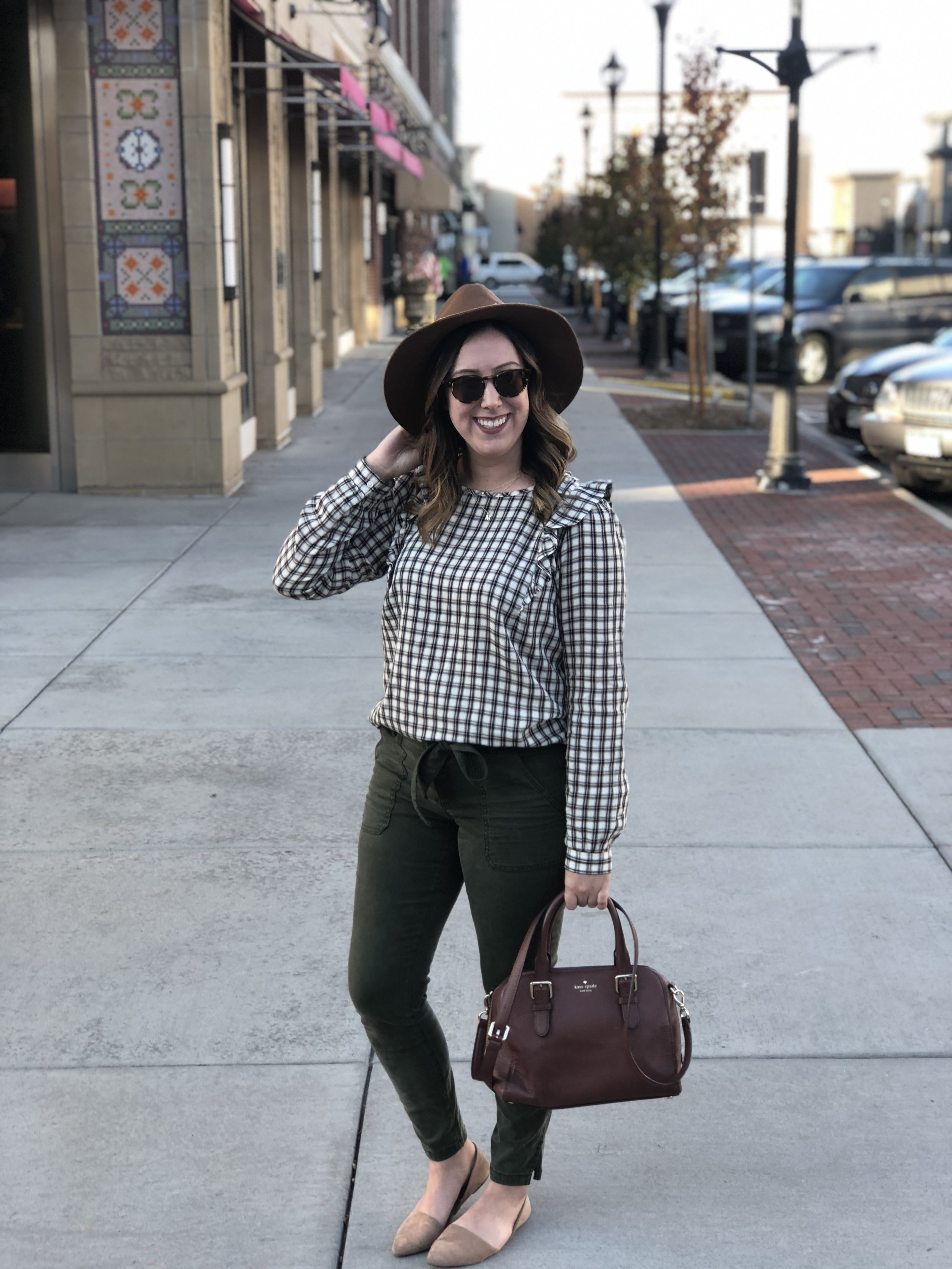 The cutest little plaid top with ruffles on the shoulder and a keyhole back!