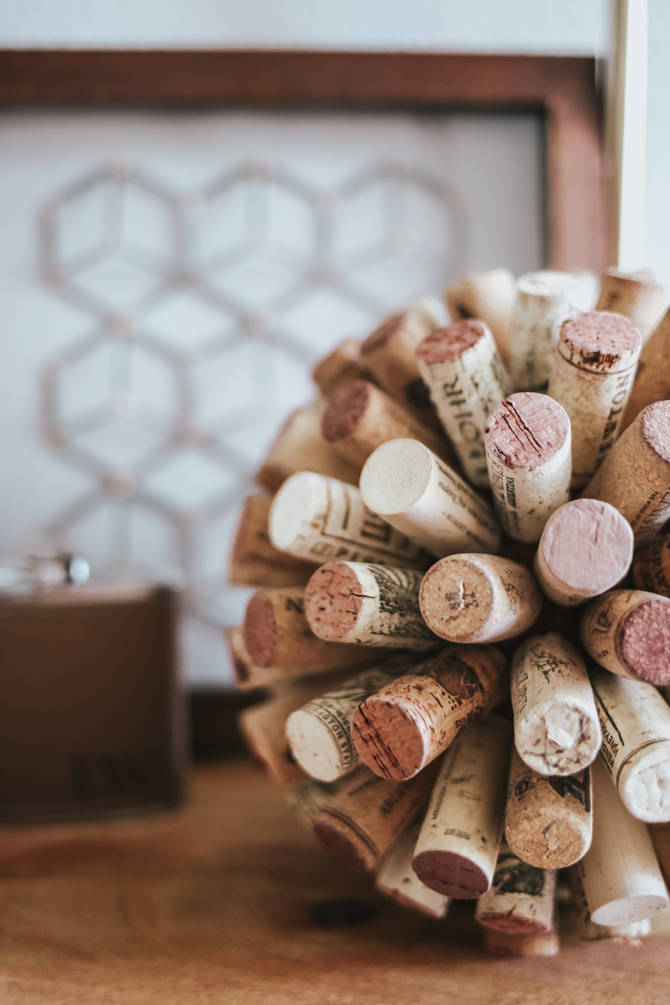 To make this DIY cork ball:  1) Get a 3 inch styrofoam ball from craft store  2) paint brown, allow to dry  3) hot glue corks as close as possible, until ball is covered (FYI it takes forever)!